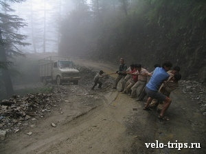 India. Road from Shimla to Rampur. We are pulling truck with indians.