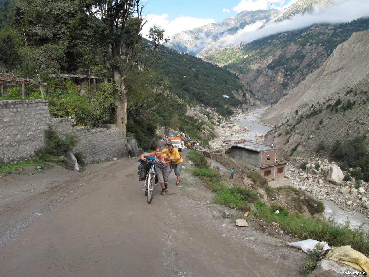 Pushing bicycles in Himalaya mountains