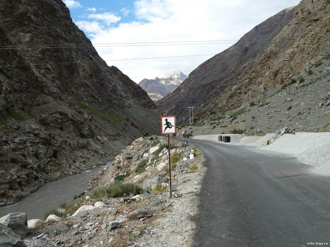 Running man on the sign. Road along Sutlej, Himalaya mountains