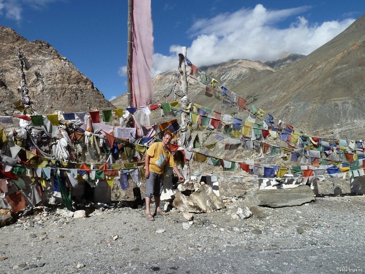 Putting mani stones to the heap on the Himalaya pass