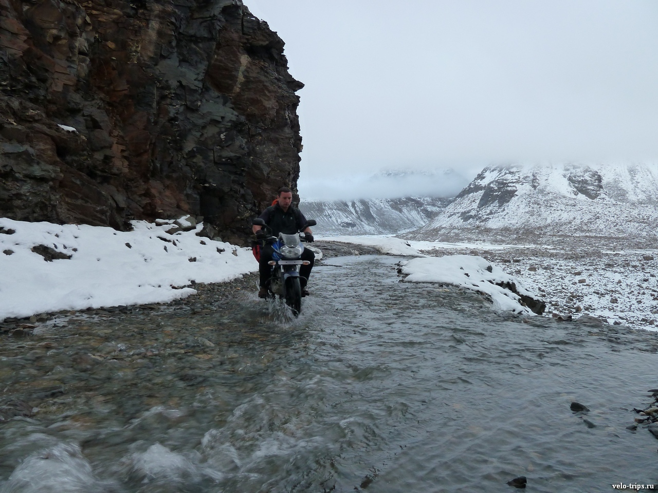 On motorcycle via water streams  in Chandra valley, Himalayas