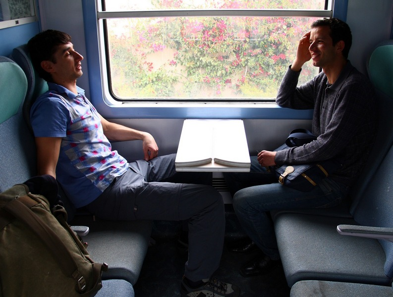 Morocco, Casablanca-Fes train. Conversation in coupe