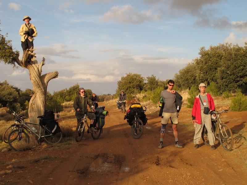 Morocco, Cirque du Jaffar. Bicycle group on the dirt road