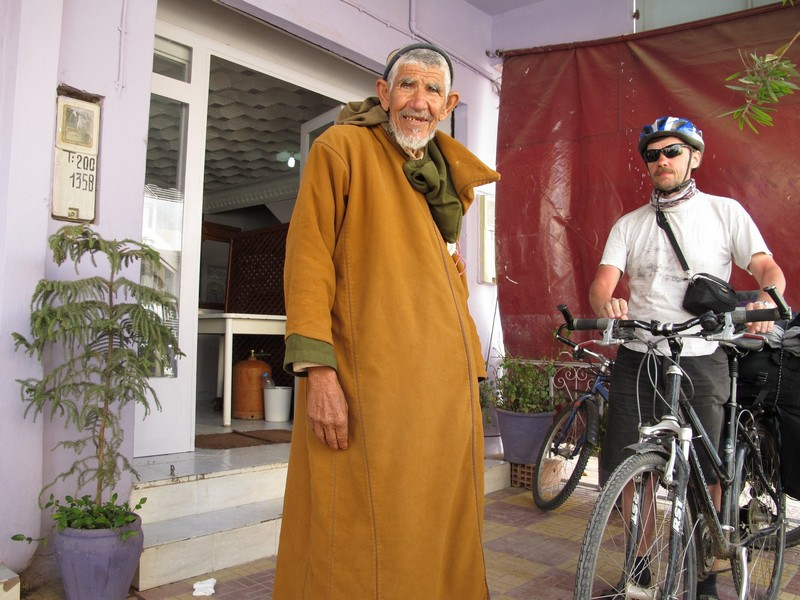 Morocco, Midelt. Russian cyclist and berber man