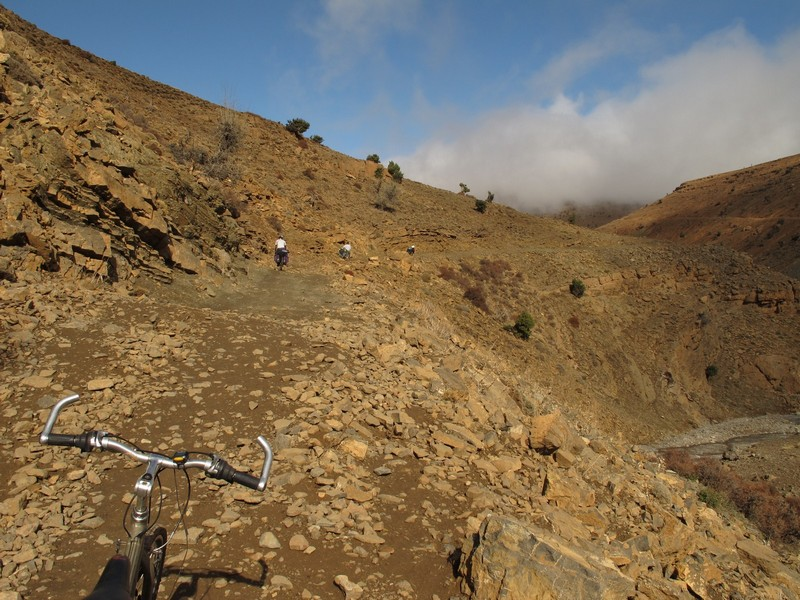 Morocco, Cirque du Jaffar. Bicycle hadle bar and the road