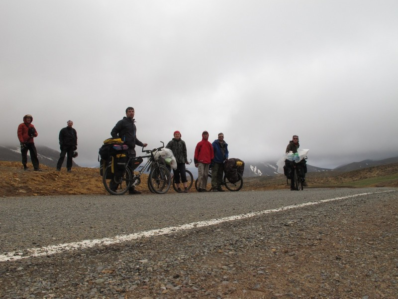 Morocco, High Atlas. Bicycle group on top of the pass