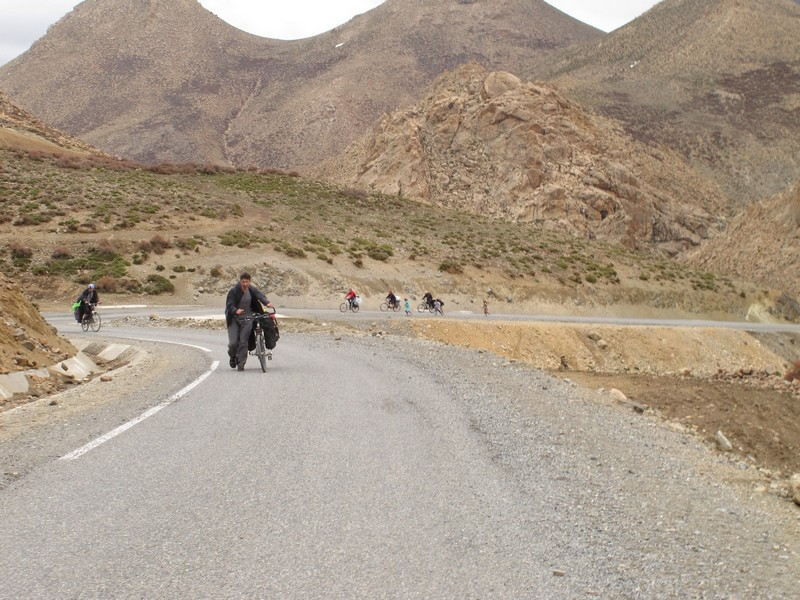 Morocco, High Atlas. Annoying children running near bicycles