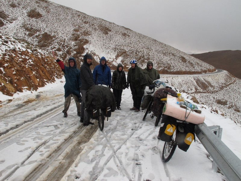 Morocco, High Atlas. Bicycle group after snow pass