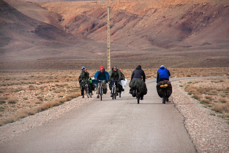Morocco, High Atlas. Cyclists meeting on the road to Tamtetoucht