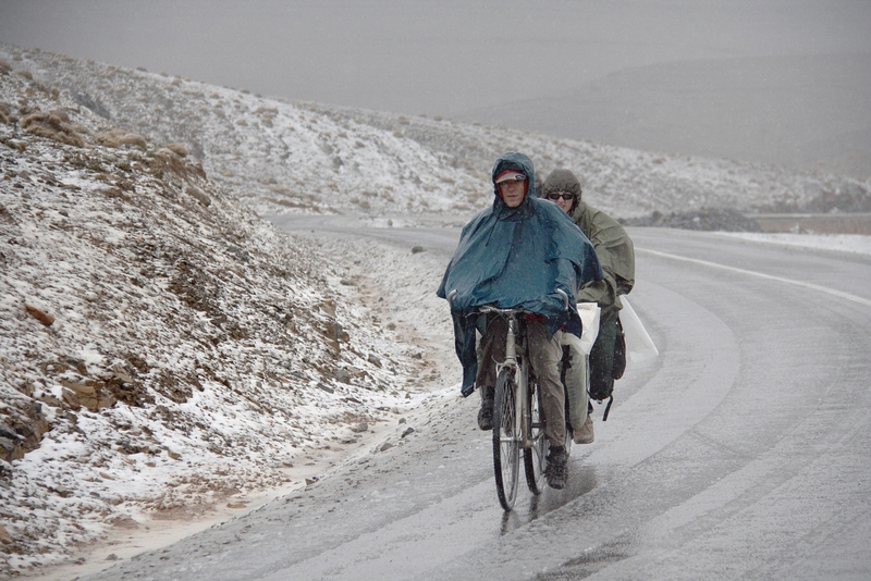 Morocco, High Atlas. Wet snow on two cyclists
