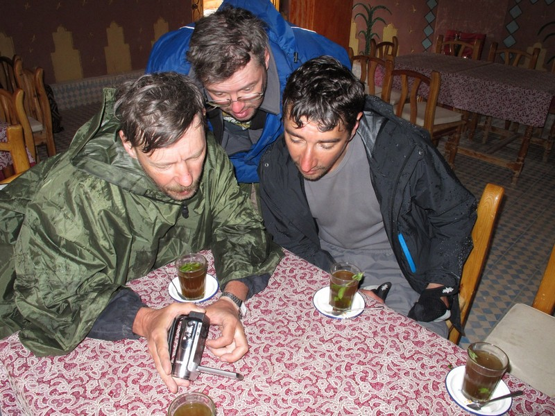 Morocco, Dades gorge. Looking at video camera in cafe
