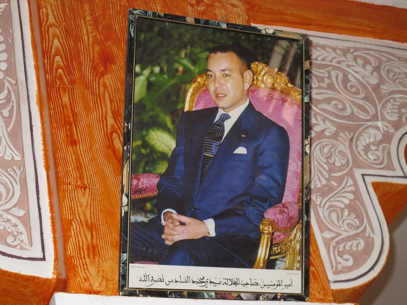 Morocco, Dades gorge. King Mohamed VI portrait in the cafe
