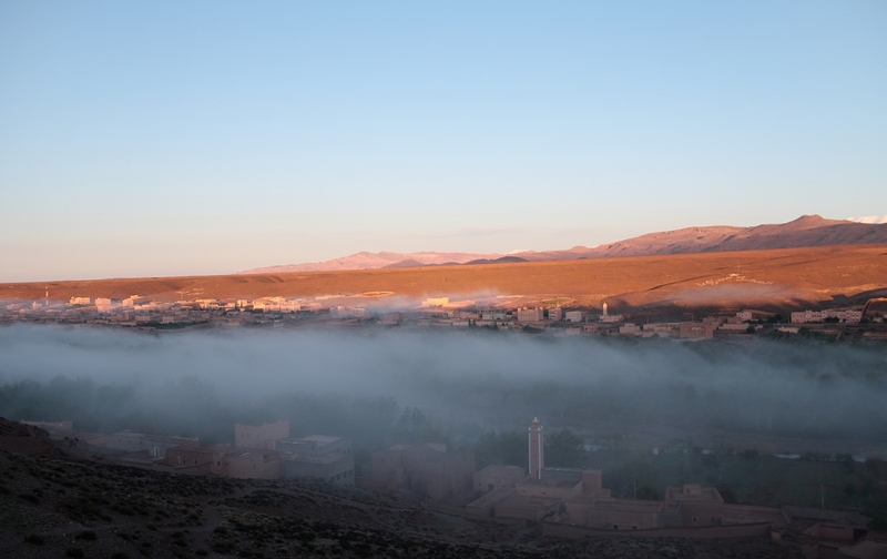 Morocco, Boumalne Dades. Morning mist on the town