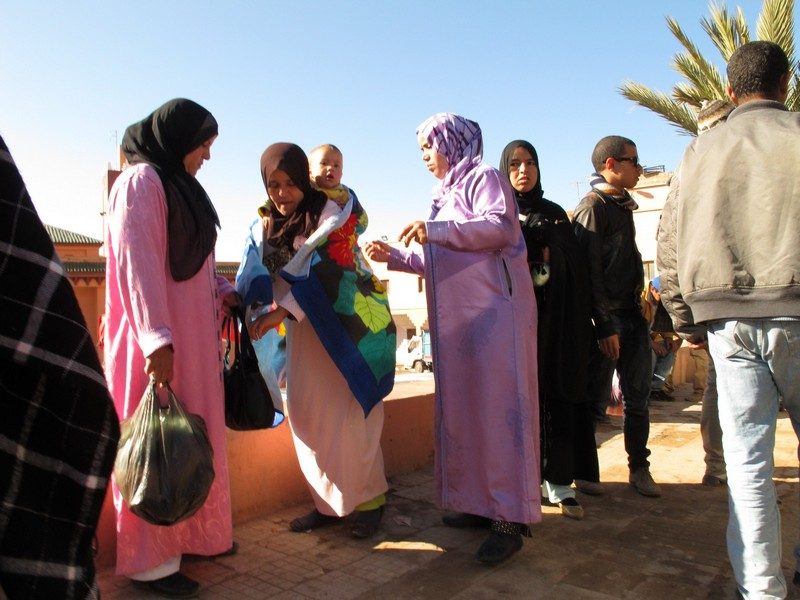 Morocco, Boumalne Dades. Womem on the bus stop