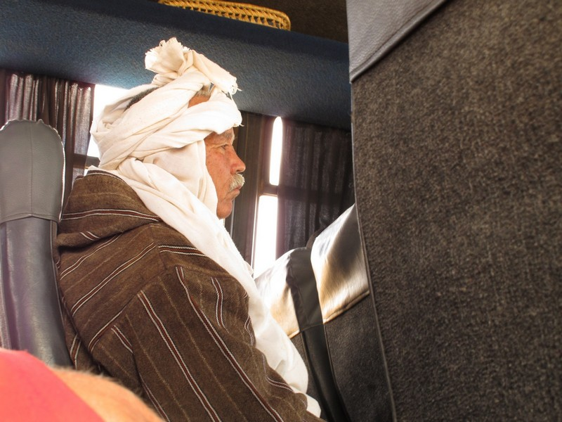 Morocco, Boumalne Dades. Berber man in the bus