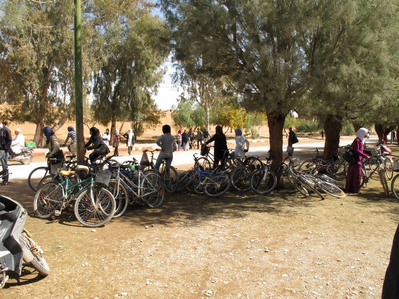 Morocco, Boumalne Dades. Pupils on the bicycles