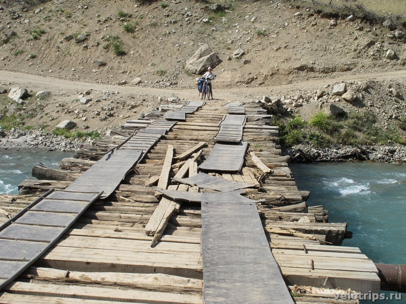 Tajikistan, Rufigar. Mountain river bridge