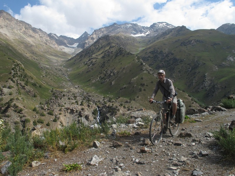 Tajikistan, Yagnob. Alone cyclist on the stone path