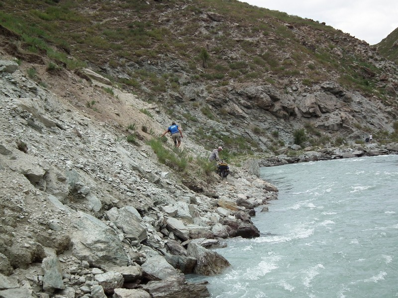 Tajikistan, Yagnob. River waters with stone bank