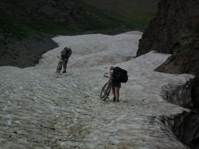Tajikistan, Rost pass. Climbing glacier with bicycles