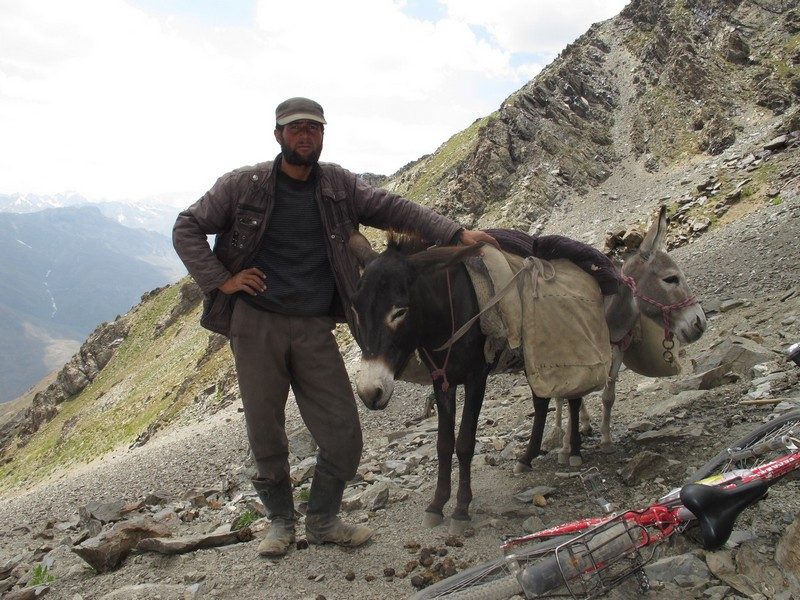 Tajikistan, Rost pass. Shepherd with donkey