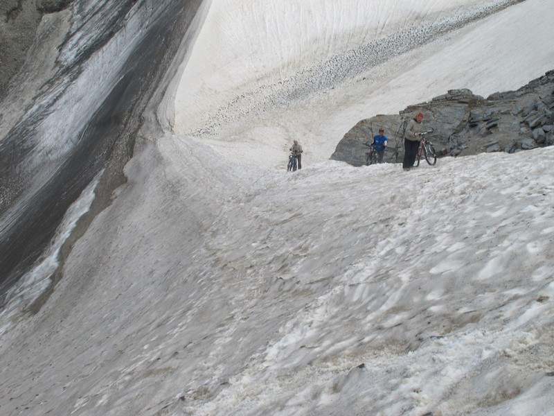 Tajikistan, Rost pass. Walking on glacier edge with bicycles