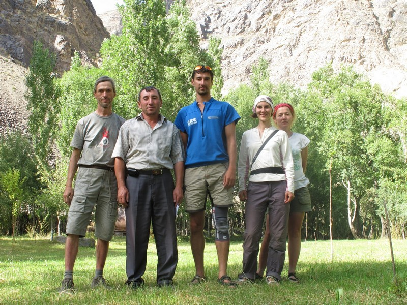 Tajikistan, Rost pass. Five people in garden