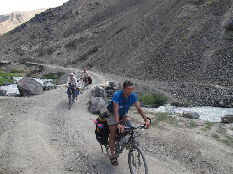 Tajikistan, Rost pass. Bicycles on road