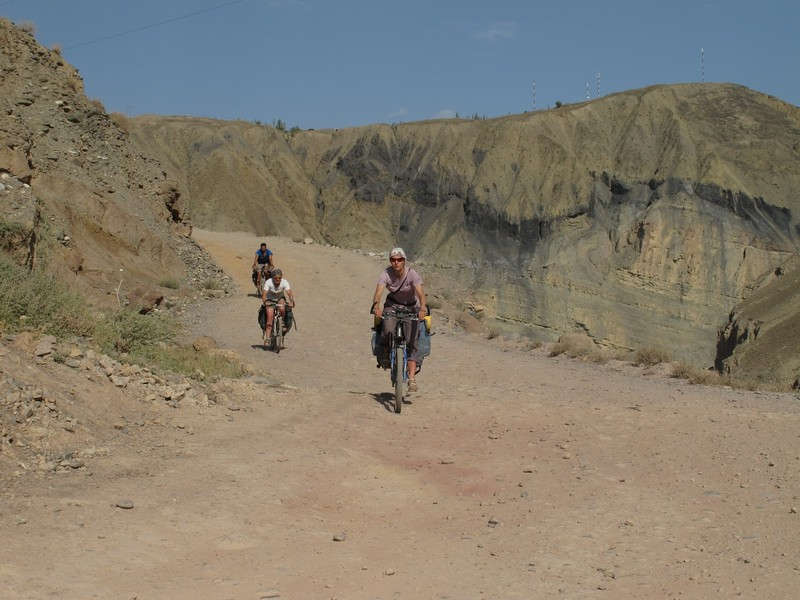 Tajikistan, Zeravshan river. Dusty road by bicycle