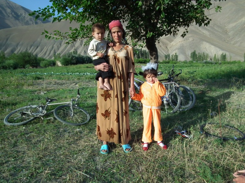 Tajikistan, Ayni. Tajik woman with 2 children
