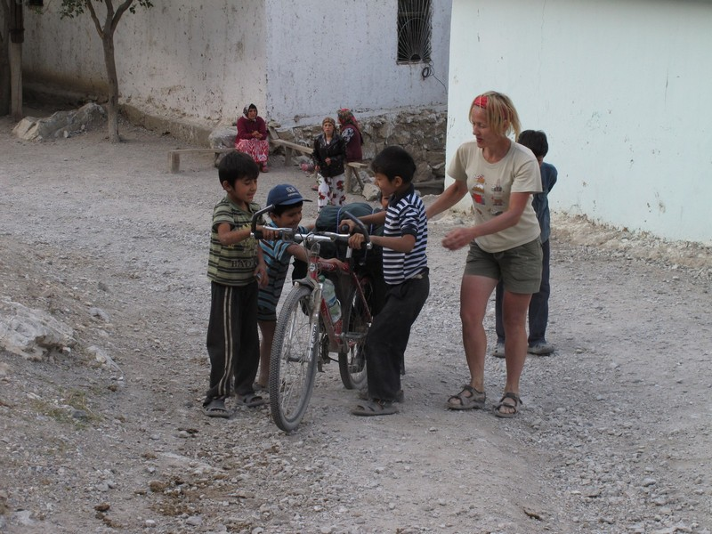 Marguzor lakes. Children from village look at bicycle