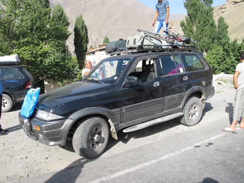 Tajikistan. Aini load bicycles to jeep